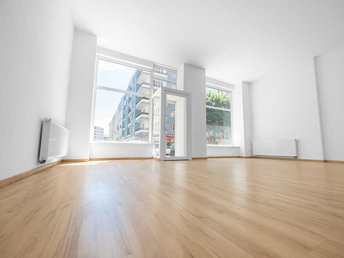 wooden floor with white walls