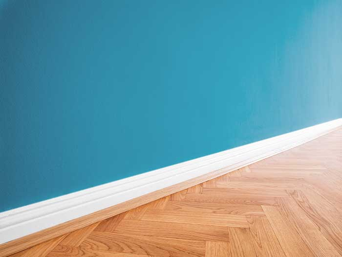 wooden floor with blue wall